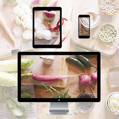 healthy foods on a table with digital devices layered on top